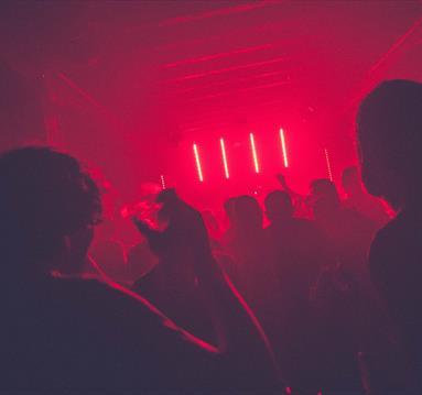 Dancing in red lit night club
