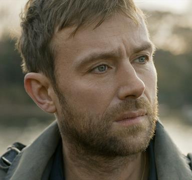Damon Albarn in grey coat