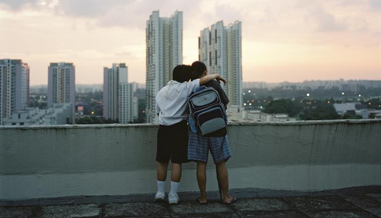 Two boys hugging