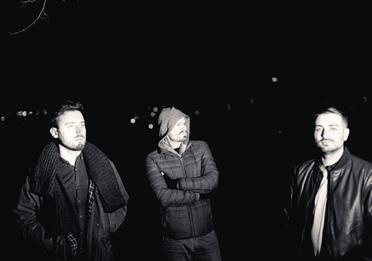 Roller Trio band members at night