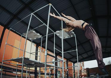 Dancer on metal bar