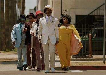 Rudy Ray Moore dressed up in a fine suit