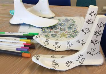 Plastic feet, decorated