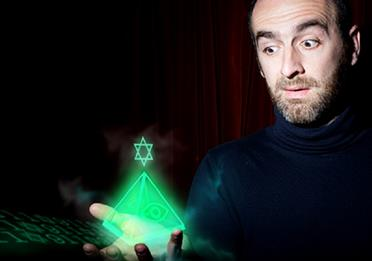 Man holds a shining pyramid in his hand