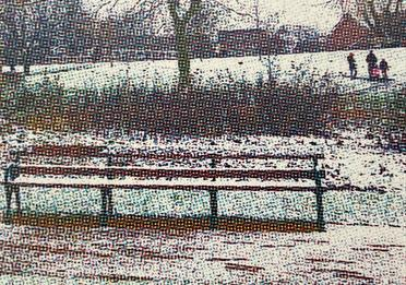 Pixelated image of a park bench