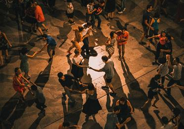 Many people dancing together in pairs