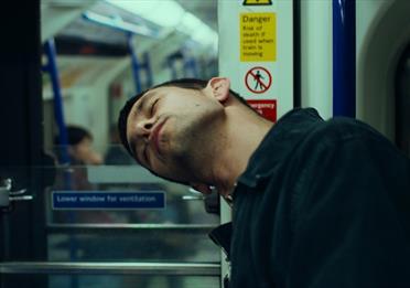Man sleeping on a metro