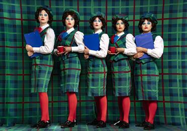 Five women in tartan outfits