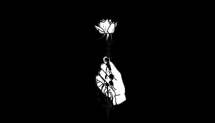 Black poster with white hand and a flower