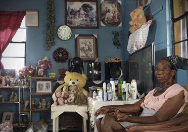 'Staying' put after disaster: life after Hurricane Irma in Barbuda: woman inside her home