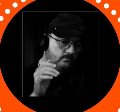 Black and white image, man in glasses, orange frame