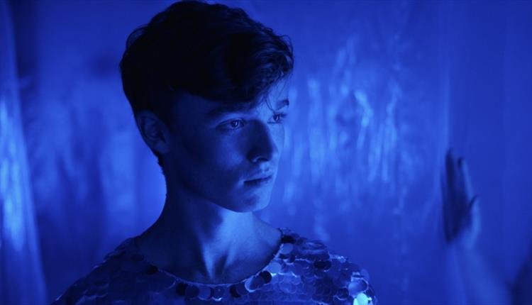 Man in a blue room