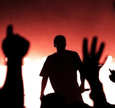 Solo rapper in energetic crowd