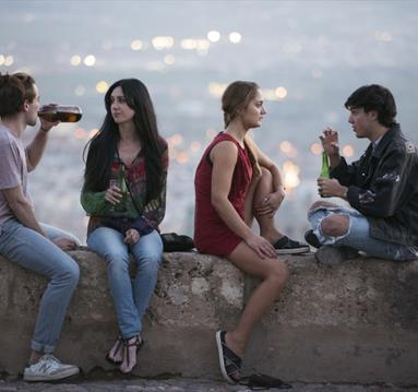 Students drinking beer, Granada in the background
