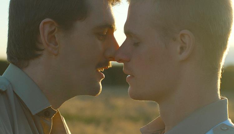 Sunset, two men up close
