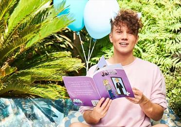 Olly Pike reading a book