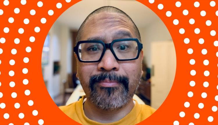 Man in black glasses, orange frame