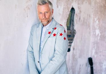 Billy Bragg in a suit