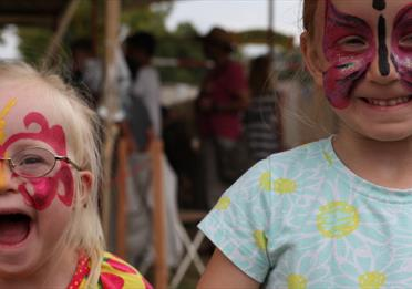 Two girls covered in face paint