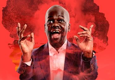 Daliso Chaponda portrait in red smoke