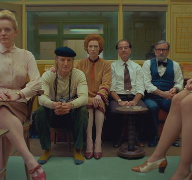 (From L-R): Elisabeth Moss, Owen Wilson, Tilda Swinton, Fisher Stevens and Griffin Dunne in the film THE FRENCH DISPATCH. Photo Courtesy of  Searchlig
