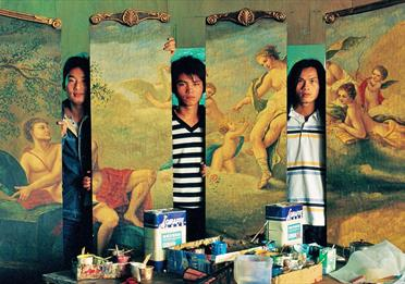 Painters next to their paintings (replicas of famous paintings)