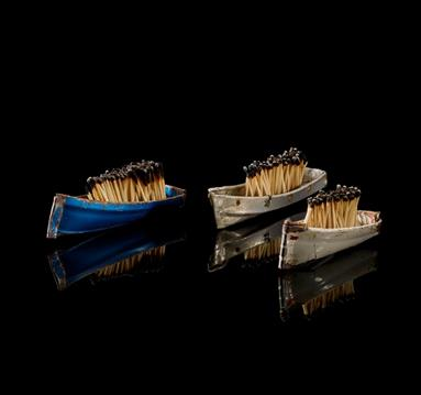 Part of the, A British Museum Spotlight Loan, Crossings: community and refuge Exhibition, small boats filled with burned matchsticks