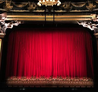 Red curtain at a performance theatre