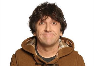 Man in brown duffle coat