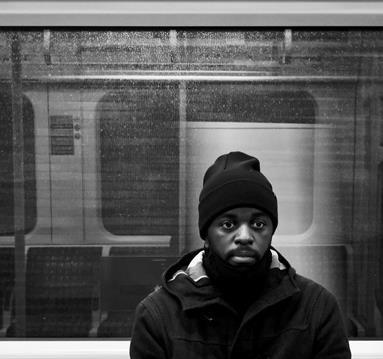 Black and white photo: Alfa Mist on a train