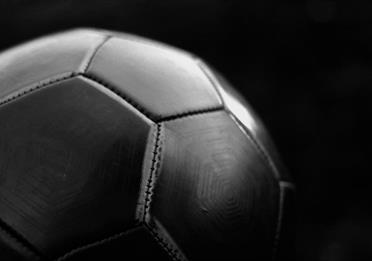Black football on dark background