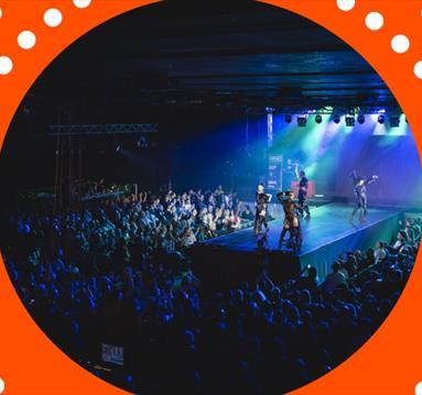 Performers on stage, orange frame
