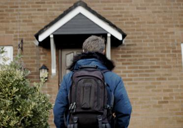 House front, child with a rucksack