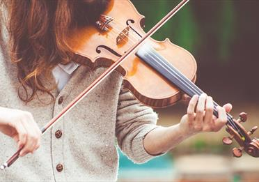 Person playing a violin