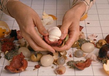 Female hands, fruit peel
