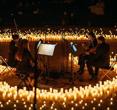 Musicians surrounded by candlelight