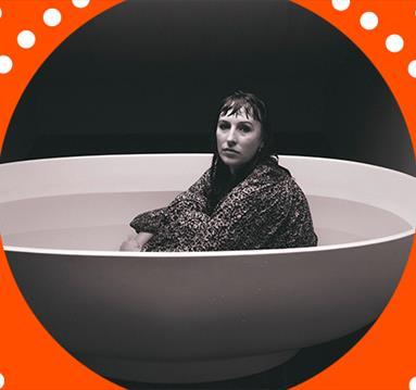 Woman in a bath, orange frame