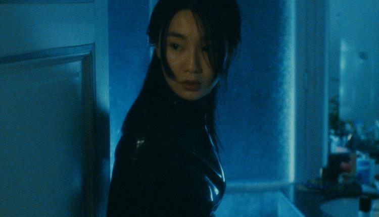 Maggie Cheung in black outfit