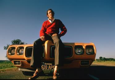 Man sitting on a car
