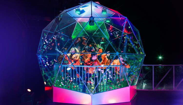 People collecting golden tickets in the Crystal Maze Manchester dome
