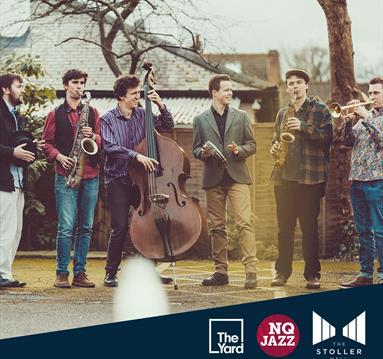 Misha Mullov-Abbado with a band
