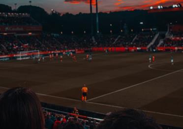 Football game at sunset in stadium