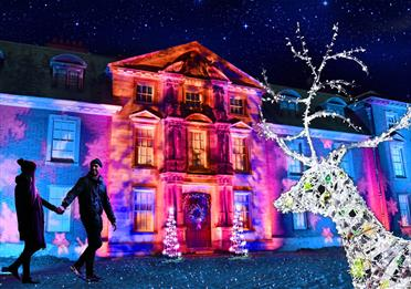 Dunham Hall lit up by the Christmas lights trail