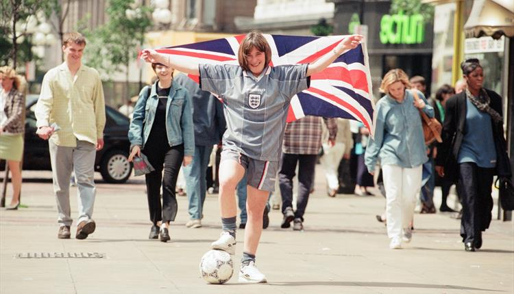 Image from Euro '96, woman in shorts