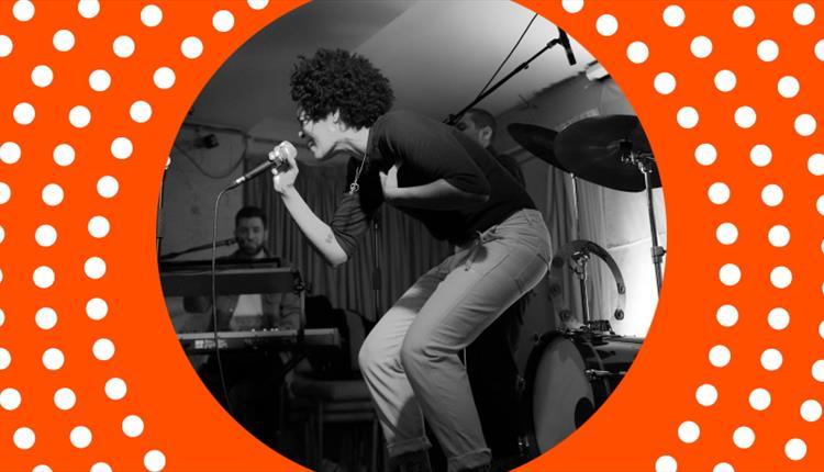 Singer on stage, orange frame
