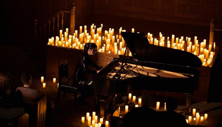 Piano surrounded with candles