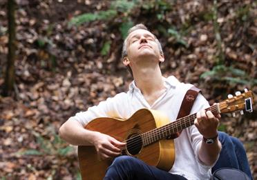 Luke Concannon with a guitar