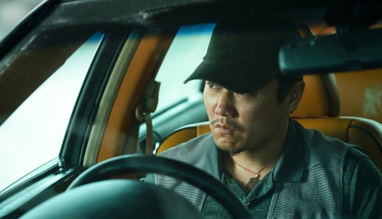 Taxi driver in a car