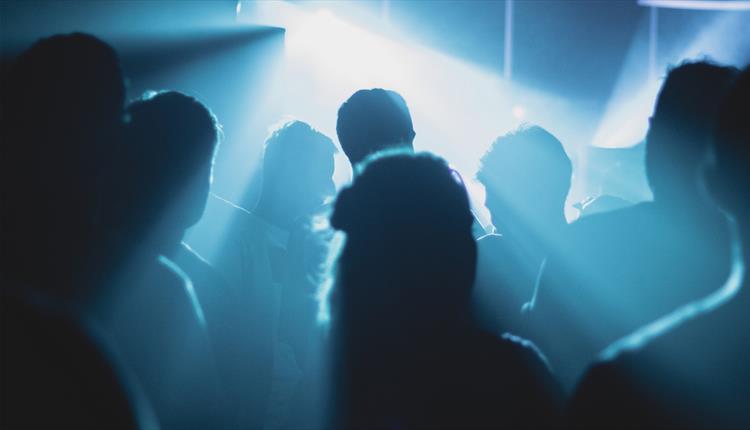 Dancer in blue lit club