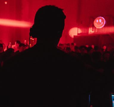 DJ and calm crowd in night club